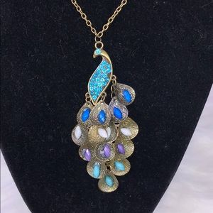Beautiful antique gold tone peacock necklace.